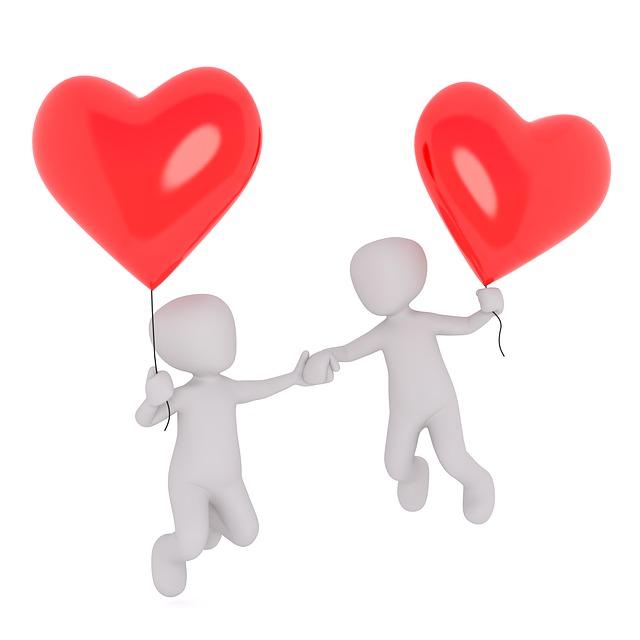 un homme et une femme se donnant la main tout en volant